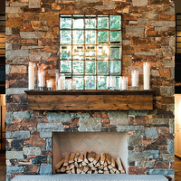 Ashley Winn Design - living rooms - stone fireplace, rustic stone fireplace, floor to ceiling fireplace, multipanel mirror, fireplace mirror, glass hurricanes, clear glass hurricane, reclaimed wood mantle, reclaimed wood fireplace mantle, salvaged wood fireplace mantle, herringbone firebox, fireplace hearth, builtin firewood storage, firewood storage, fireplace hearth cubbies, fireplace hearth storage, fireplace hearth cut firewood storage,