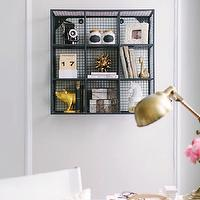 The Every Girl - dens/libraries/offices - Farrow & Ball - Cornforth White - living room desk, living room office, office, cornforth white, light gray walls, light gray paint, light gray paint colors, farrow and ball paint colors, farrow and ball gray paint colors, decorative wall moldings, wall moldings, sift raw wall shelf, cb2 shelf, cb2 wall shelf, gold pig, cb2 gold pig, pig bookends, gold pig bookends, cb2 pig bookends, horse head jar, horn box, textured horn box, chalkboard jars, chalkboard spice jars, shuffle calendar, gold urchin,