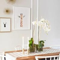 The Every Girl - dining rooms - Farrow &amp; Ball - Cornforth White - light gray walls, light gray dining room walls, cornforth white, light gray paint, light gray paint colors, wall moldings, decorative wall moldings, sharon montrose animal prints, the animal print shop, baby giraffe close up, parsons dining table, room and board dining table, white dining chairs, west elm dining chair, white west elm dining chair, chevron table runner, gray chevron table runner, ikat table runner, gray ikat table runner, williams-sonoma table runner, bold ikat table runner, dining room art,