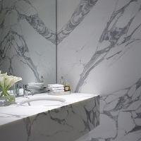 Burley Katon Halliday - bathrooms - marble bathroom, marble slab bathroom, sloped ceiling, bathroom sloped ceiling, sloped ceiling bathroom, marble slab walls, marble floating sink, marble floating washstand, marble floating vanity, floating marble sink, floating marble vanity, floating marble washstand, vanity with shelf, bathroom tray, silver bathroom tray, frameless mirror,