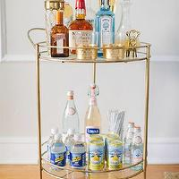The Every Girl - dining rooms: gold bar cart, round bar cart, marni glass, gold glass, scalloped glass, gold scalloped glass, scalloped gold glass, cornforth white,