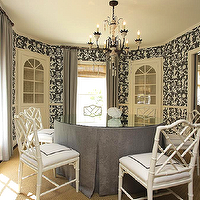 Chandos Interiors - dining rooms - round dining room, circular dining room, cream ceiling, shantung silhouette wallpaper, shantung silhouette wallpaper smoke, smoke shantung silhouette wallpaper, schumacher wallpaper, chinoiserie wallpaper, gray chinoiserie wallpaper, built in china cabinets, dining room cabinets, built in dining room cabinets, glass front cabinets, built in glass front cabinets, floor to ceiling curtains, gray curtains, gray drapes, gray window panels, candle chandelier, dining room chandelier, round dining table, skirted dining table, round skirted dining table, gray skirted dining table, gray dining table, round gray dining table, glass top dining table, bamboo chair, white bamboo chair, faux bamboo chair, white faux bamboo chair, white dining chair, white bamboo dining chair, layered window treatments, corner china cabinet,