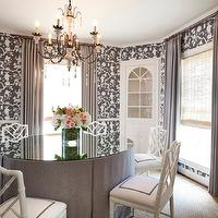 Chandos Interiors - dining rooms - round dining room, circular dining room, shantung silhouette wallpaper, shantung silhouette wallpaper smoke, smoke shantung silhouette wallpaper, schumacher wallpaper, chinoiserie wallpaper, gray chinoiserie wallpaper, built in china cabinets, dining room cabinets, built in dining room cabinets, glass front cabinets, built in glass front cabinets, floor to ceiling curtains, gray curtains, gray drapes, gray window panels, candle chandelier, dining room chandelier, round dining table, skirted dining table, round skirted dining table, gray skirted dining table, gray dining table, round gray dining table, glass top dining table, bamboo chair, white bamboo chair, faux bamboo chair, white faux bamboo chair, white dining chair, white bamboo dining chair, layered window treatments, corner china cabinet,