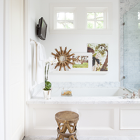 Ashley Goforth Design - bathrooms - marble bathroom, marble basketweave tile, marble basketweave tile floor, marble basketweave bathroom floor, marble basketweave floor, drop in tub, spa like bathroom, spa bathroom, spa master bathroom, paneled bathtub, paneled tub, wood paneled tub, wood paneled drop in tub, marble tub surround, bath shelf, floating bath shelf, bathtub shelf, wood sunburst mirror, small sunburst mirror, bathroom art, picture ledge, bathroom picture ledge, bathroom tv, costello stool, bathroom stool, luxurious bathroom, luxurious master bathroom,