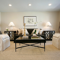 Ashley Goforth Design - living rooms: dark brown sofa, white and gray pillows, mirrored end tables, elisabeth bedside table, oly studio tables, oly studio mirrored chest, espresso end tables, dark brown end tables, dark brown chest, mirrored chest, glass column lamp, espresso coffee table, mirror coffee table, mirrored coffee table, 2 tone curtains, striped curtains, striped drapes, striped window panels, cream and brown curtains, cream and brown drapes, cream and brown window panels, slipcovered chairs, linen accent chairs, dark brown pillows, sisal rug,