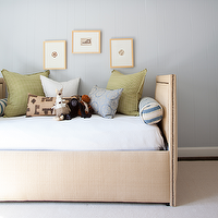 Ashley Goforth Design - boy&#039;s rooms: daybed, nailhead daybed, boys daybed, linen daybed, daybed with nailhead trim, upholstered daybed, wall panels, blue wall panels, blue wood panels, blue wood paneling, boys art, boys bolster pillow, striped bolster pillow, white and blue bolster pillows, green gingham pillow, gingham pillow, geometric pillow, blue geometric pillow, boys room, boys bedroom,