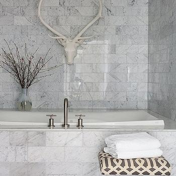 Pieces Inc - bathrooms - carrara marble, carrara marble bathroom, carrara marble tile, carrara marble tile bathroom, lucite ottoman, bathroom ottoman, imperial trellis ottoman, gray trellis ottoman, trellis ottoman, drop in tub, carrara marble drop in tub, marble tile floor, carrara marble tiled floor, carrara marble tiled walls, decorative antelope head, Kelly Wearstler Imperial Trellis in Parchment/Midnight,