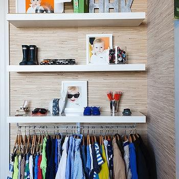 Modern boy's closet design with raffia wallpaper framing stacked modern floating ...