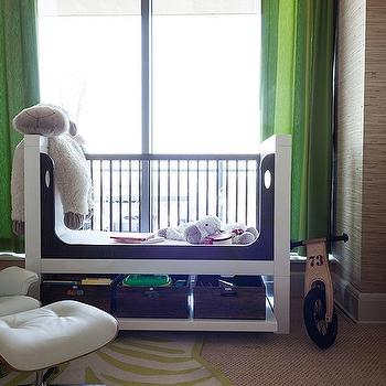 Sweet boy's nursery design with tan raffia wallpaper paired with green curtains ...