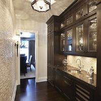 Parkyn Design - kitchens - butlers pantry, butlers kitchen, hardwood floors, dark hardwood floors, round stainless steel sink, stainless steel bar sink, undermount stainless steel sink, ceiling height cabinets, ceiling height cabinetry, tiled accent wall, mini mosaic tiled accent wall, torchiere sconce, baseboards, espresso cabinets, espresso cabinetry, pantry cabinets, black counters, black countertops, natural stone mosaic backsplash, brushed nickel faucet, gooseneck faucet, glass fronted cabinets, leaded glass front cabinets, leaded glass kitchen cabinets, under cabinet lighting, hexagonal flush mount pendant, hexagonal glass and iron kitchen pendant, flush mount kitchen pendant, glass fronted wine fridge, built-in wine fridge, glass front wine fridge,