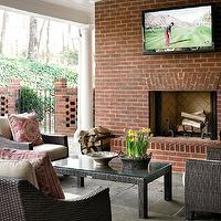 Allison Hennessy - decks/patios - covered patio, covered deck, deck columns, patio columns, deck tv, deck flatscreen tv, patio flatscreen tv, deck tv, patio tv, red brick fireplace, brick fireplace, deck fireplace, patio fireplace, deck fireplace tv, patio fireplace tv, fireplace hearth, brick hearth, brick fireplace hearth, outdoor furniture, coral pink pillows, outdoor pillows, slate tile floor,