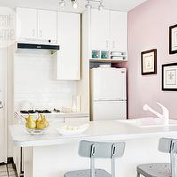 Style at Home - kitchens - white and pink kitchen, pink accent wall, pink kitchen wall, white cabinets, small kitchen, small white kitchen, cabinets over fridge, cabinets above fridge, cabinets over stove, cabinets above stove, laminate countertops, white countertops, white laminate countertops, vintage refrigerator, white vintage refrigerator, subway tile kitchen, subway tile backsplash, kitchen island sink, gray bar stools, gray vintage bar stools, industrial bar stools,