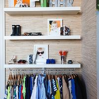 Modern boy's closet design with raffia wallpaper framing stacked modern floating shelves ...