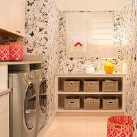 Design Transformations - laundry/mud rooms - laundry room, whimsical laundry room, birds and butterflies wallpaper, laundry room alcove, laundry room folding station, built in cabinets, laundry room cabinets, laundry room built ins, laundry room built in cabinets, woven baskets, yellow table lamp, yellow lamp, geometric lamp, yellow geometric lamp, silver washer and dryer, silver front load washer and dryer, pandan baskets, pink pandan baskets, vintage hex tile floor, vintage hex floor, laundry room cabinets, ivory cabinets, laundry room storage,