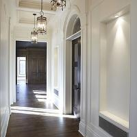 Parkyn Design - entrances/foyers - hall niche, hallway niche, niches, hardwood floors, crown molding, moldings, tray ceiling, coffered ceiling, traditional ceiling, arched doors, arched doorways, white walls, lit hallway niches, traditional hallway, traditional hall, wall moldings, iron lantern pendant, glass and iron lantern, lantern pendant,