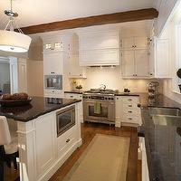 Parkyn Design - kitchens - white kitchen cabinetry, white kitchen cabinets, white cabinetry, white cabinets, hardwood floors, sisal runner, bound sisal rug runner, stainless steel double sink, undermount stainless steel double sink, leaded glass kitchen window, black countertops, black granite countertops, black granite counters, black granite, built-on coffee maker, coffee maker, stainless steel microwave, built-in stainless steel microwave, brushed nickel faucet, brushed nickel gooseneck faucet, gooseneck faucet, ceiling height cabinets, ceiling height kitchen cabinets, kitchen island, wood beamed ceiling, exposed beam ceiling, stainless steel oven, paneled oven hood, white oven hood, built-in oven hood, white subway tiled backsplash, white subway tile, subway tiled backsplash, white cabinets black countertops, white leather barstools, contemporary drum pendant, topiaries, Quoizel Drum Pendant, quoizel pendants, quoizel chandeliers, quoizel lighting,