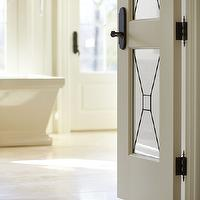 Parkyn Design - bathrooms - glass paned door, leaded glass paned door, contemporary leaded glass paned door, glass paneled door, glass paneled bathroom door, leaded glass paneled bathroom door, limestone tile, limestone tiled floor, limestone tiled bathroom floor, rectangular bath tub, freestanding bath tub, freestanding bath, rectangular pedestal tub, rectangular pedestal bath,