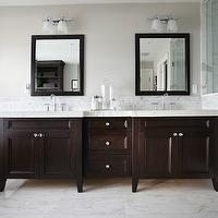 Parkyn Design - bathrooms: espresso vanity, double vanity, master bathroom, his and hers sinks, dual sinks, double bathroom vanity, footed espresso vanity, marble tiled floors, marble counters, marble countertops, espresso framed mirrors, gooseneck faucet, frosted glass double sconces, heated towel rack, heated towel rail, bathroom tv, bathroom television, mini marble mosaic border, marble tiled shower, walk-in shower, seamless shower door, seamless glass shower door, pale greige walls, greige walls, greige bathroom walls, marble tiled bathroom, marble bathroom, master bath, espresso double vanity, espresso vanity with white countertop, espresso vanity with white marble countertop, espresso cabinets with white countertops, espresso cabinets with white marble countertops, espresso bathroom cabinets with white countertops, espresso bathroom cabinets with white marble countertops,