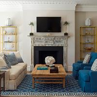 James Michael Howard - living rooms: beadboard ceiling, brass etagere, weathered fireplace, weathered fireplace mantle, fireplace tv, fireplace topiary, greek key rug, blue greek key rug, trellis rug, blue trellis rug, trellis and greek key rug, reclaimed wood coffee table, salvaged wood coffee table, blue chairs, blu slipcovered chairs, ivory slipcovered sofa, blue pillows,