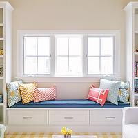 Lauren Nelson Design - girl's rooms - girls bedroom, bookshelves, built-in bookshelves, window seat, built-in window seat, window seat storage, window seat with drawers, built-ins flanking window, built-in bookshelves and window seat, toys, books, blue bench cushion, yellow and green floral pillows, yellow and white chevron pillow, coral lattice pillow, coral pink greek key pillow, pale blue pillow, yellow and white plaid rug, yellow and white gingham rug, white chair, blue and white geometric pillow, cafe au lait wall color, cafe au lait walls,