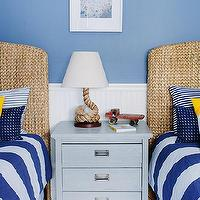 Lauren Nelson Design - boy&#039;s rooms - nautical kids room, beachy bedroom, beachy kids room, beach themed kids room, nautical themed kids room, blue walls, blue wall color, beadboard walls, white beadboard walls, white beadboard half walls, light blue nightstand, striped blue and white bedding, striped blue and white duvet cover, blue white and yellow striped pillows, bleu and white striped pillows, rope lamp, jute rope lamp, twisted rope lamp, beach art, beachy art, twin beds, pair of twin beds, blue and yellow kids room, seagrass headboards, light seagrass headboards, woven headboards, white and blue bedding, white and blue striped bedding,