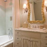 James Michael Howard - bathrooms - pink and gray bathroom, pink shower curtain, shower curtain, seashell mirror, gold seashell mirror, weathered vanity, weathered bathroom vanity, gray vanity, gray bathroom vanity, weathered cabinets, weathered bathroom cabinets, gray weathered cabinets, calcutta marble countertops, calcutta marble top vanity, oil rubbed bronze sconce, drop in tub, weathered drop in tub, gray weathered tub,