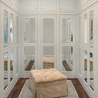 All Alabama - closets - walk in closet, walk in closet design, U shaped closet, built ins, built in cabinets, closet built ins, closet built in cabinets, floor to ceiling cabinets, floor to ceiling built ins, floor to ceiling built in cabinets, mirrored doors, closet doors, cabinet doors, mirrored cabinet doors, mirrored closet doors, tufted ottoman, closet ottoman, blue and gray rug,