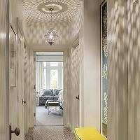 Palmer Weiss - bedrooms - hallway, hall, pierced lanterns, pierced metal lanterns, yellow bench, velvet bench, yellow velvet bench, greek key rug, brown greek key rug, white and brown greek key rug,