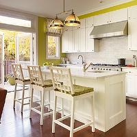 Palmer Weiss - dining rooms - white and green kitchen, white and green kitchen design, avocado green walls, avocado green kitchen walls, white cabinets, white kitchen cabinets, white marble countertops, linear marble tile, linear marble tile backsplash, linear marble backsplash, clemson double pendant, restoration hardware pendants, white marble kitchen island, white marble top kitchen island, prep sink, island prep sink, kitchen island prep sink, overlapping squares bar stools, overlapping squares counter stools, white overlapping squares bar stools, white overlapping squares counter stools, avocado green cushions, avocado green seat cushions,