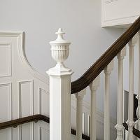 James Michael Howard - entrances/foyers - pale blue walls, stairwell, creamy white wainscoting, stairwell wainscoting, stained hand rail, white wood spindles, stairwell design,