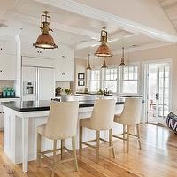 Kate Jackson Design - kitchens - hardwood floors, light hardwood floors, open plan, open concept, open plan kitchen, open concept kitchen, white cabinets, white cabinetry, white kitchen, white kitchen cabinets, white kitchen cabinetry, white cabinets with black countertops, black countertops, black counters, oil-rubbed bronze hardware, ceiling height cabinets, white refrigerator, white fridge, upholstered counter stools, barrel back counter stools, sash windows, double hung windows, copper pendants, copper kitchen pendants, industrial pendants, industrial copper pendants, farm sink, farmhouse sink, apron front sink, vaulted ceilings, whitewashed ceilings, white washed vaulted ceilings, tongue and groove ceilings, tongue and groove paneled ceilings, 1940&#039;s French Upholstered Barrelback Counter Stools, restoration hardware bar stools,