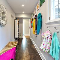 Clean Design Partners - laundry/mud rooms: hallway mudroom, mudroom, mudroom storage, hall mudroom, long mudroom, tiled mudroom, wooden bench, contemporary wooden bench, porcupine mirror, white porcupine mirror, gray walls, mudroom cubbies, coat hooks, kids art, cable picture hanger, cable picture hanging system, recessed lighting, pot lights, oversized tiled floors, brown tiled floors, Horchow Janice Minor White &#034;Porcupine Quill&#034; Mirror, long and narrow mud room, long and narrow mudroom,
