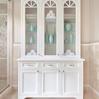 Clean Design Partners - bathrooms - Benjamin Moore - Natural Cream - crema marfil marble tiled walls, crema marfil marble tiled floors, crema marfil marble shower enclosure, crema marfil marble bathroom, white cabinet, white glass fronted cabinet, white bathroom cabinet, freestanding bathroom cabinet, aqua blue vases, aqua vases, seamless shower, seamless glass shower, walk-in shower, stand alone shower, arched glass fronted cabinet, crown molding, Crema Marfil Marble Tile, Studium Sophie Tiles,