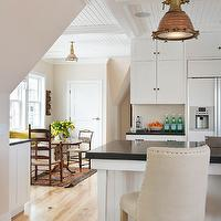 Kate Jackson Design - kitchens - hardwood floors, light hardwood floors, open plan, open concept, open plan kitchen, open concept kitchen, white cabinets, white cabinetry, white kitchen, white kitchen cabinets, white kitchen cabinetry, white cabinets with black countertops, black countertops, black counters, oil-rubbed bronze hardware, ceiling height cabinets, white refrigerator, white fridge, upholstered counter stools, barrel back counter stools, sash windows, double hung windows, copper pendants, copper kitchen pendants, industrial pendants, industrial copper pendants, whitewashed ceilings, tongue and groove ceilings, whitewashed tongue and groove ceilings, tongue and groove paneled ceilings, pedestal table, ladderback chairs, ladder back chairs, ladder back dining chairs, 1940's French Upholstered Barrelback Counter Stools,