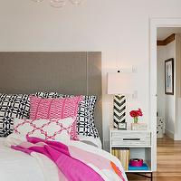 Kate Jackson Design - bedrooms - white walls, white bedroom walls, gray headboard, upholstered gray headboard, modern gray headboard, tile inlaid nightstand, inlaid wood nightstand, contemporary inlaid wood nightstand, black and white chevron lamp, black and white chevron table lamp, hardwood floors, light hardwood floors, hardwood floors, woven rug, white duvet, black and white pillows, black and white geometric pillows, pink and white throw, pink and white trellis pillow, pink white and orange fringed throw, hot pink and white pillow, Bubble Chandelier, Wood Tiled Nightstand, pink gray and black bedroom, gray pink and black bedroom, west elm nightstand,