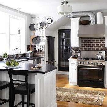 Urrutia Design - kitchens - white kitchen, brown subway tile, brown subway tile kitchen, brown subway tile backsplash, white cabinets with brown subway tile, ventahood, dcs range, black range, miele dishwasher,