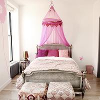 A little Muse - girl's rooms - pink girls room, pink girls bedroom, bed canopy, girls bed canopy, pink bed canopy, french bed, cane bed, gray cane bed, gray french bed, white and pink bedding, pink pillows, ottomans, ottomans at foot of bed, moroccan table, moroccan nightstand, pink flower wall decals,