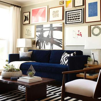 Emily Henderson - living rooms: light gray walls, light gray paint, light gray paint colors, striped rug, black and white striped rug, ikea rug, stockholm rug, mid century modern chairs, west elm coffee table, raw edge coffee table, west elm rug, ink blue sofa, velvet sofa, blue sofa, blue velvet sofa, west elm sofa, art over sofa, art above sofa, abstract art,