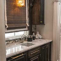 Vanessa Deleon - kitchens: wet bar, bar, bar area, dark stained cabinets, raised panel cabinets, dark raised panel cabinets, dark stained cabinetry, wet bar cabinets, wet bar cabinetry, black cabinets, black wet bar cabinets, black cabinets with white marble countertops, brass hardware, brass cabinet hardware, white marble counters, white marble countertops, undermount sink, bar sink, undermount bar sink, polished chrome faucet, moroccan tiled backsplash, moroccan tile backsplash, antiqued silver moroccan tile backsplash, wooden valance, hardwood floors, hidden dishwasher, black corbels, arabesque tile, arabesque backsplash, mosaic arabesque tile, mosaic arabesque backsplash, mercury glass pendant, mercury glass light pendant, black roman shade, grosgrain roman shade, black and white roman shade, wet bat lighting, wet bar pendants, paneled dishwasher, black paneled dishwasher, wet bar design,