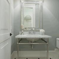 Maison Market - bathrooms - washstand, marble topped washstand, washstand with marble countertops, mirror tiled mirror, mirror framed mirror, polished nickel sconces, polished nickel bathroom sconces, shaded polished nickel sconces, gray walls, gray wall color, gray bathroom walls, gray powder room walls, white hex tile, black and white hex tile, white hex tile, hexagonal white floor tile, mini hex floor tile, black and white hex tiled floors, 2 leg washstand, marble top washstand,