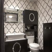 Vanessa Deleon - bathrooms - moroccan wallpaper, black and white moroccan wallpaper, trellis wallpaper, moroccan tile wallpaper, modern espresso vanity, footed espresso vanity, flared trough sink, trough sink, circular silver hardware, silver footed bathroom vanity, mirror framed mirror, mirror framed vanity mirror, gray tiled floors, gray floor tile, espresso cabinet, toilet cabinet, white glass flush mount pendant, flush mount pendant, black and white wallpaper, black and white trellis wallpaper, moroccan wallpaper, moorish tile wallpaper, black and white moroccan wallpaper, black and white moorish tile wallpaper,