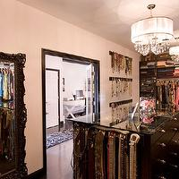 Vanessa Deleon - closets - black shelves, black closet shelving, closet storage, black closet shelves, black closet island, silver hardware, walk-in closet shelves, walk-in closet shelving, jewelry wall hangers, closet island, closet island with glass top, glass topped black closet island, black floors, black hardwood floors, ivory walls, ivory wall color, clothes rails, belt storage, drum pendant chandelier, master closet, master bedroom closet, black baseboards, black trim, walk-in closet, walk-in wardrobe, ornate black mirror, black floor mirror, black framed floor mirror, baroque floor mirror, black baroque mirror, black baroque floor mirror,