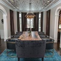 Vanessa Deleon - dining rooms - live edge dining table, live edge wood dining table, live edge wooden dining table, rustic wooden dining table, iron and leather barrel back chairs, leather barrel back chairs, barrel back dining chairs, iron candlesticks, silver candlesticks, orchid, white orchid, bay window, bay window in dining room, floor length drapes, floor length curtains, chocolate brown velvet drapes, chocolate brown velvet curtains, brown velvet drapes, brown velvet curtains, overdyed rug, overdyed teal rug, over-dyed rug, over-dyed teal rug, hardwood floors, floor length mirror, paneled floor mirror, zinc pendants, zinc antiqued mirror pendants, arched doorway, wallpapered ceiling, silver foil floral wallpaper, silver and black floral wallpapered ceiling, wallpapered dining room ceiling, teal rug, velvet tufted chairs, velvet tufted end chairs, velvet button tufted end chairs, greige walls, greige wall color, white trim, white moldings, Arteriors Calvin Chair, reclaimed wood dining table, black dining chairs, black leather dining chairs, back tufted chairs, black drapes, black window panels, black velvet settee, black tufted settee, black velvet settee, black velvet tufted settee, salvaged wood dining table, reclaimed wood dining table, black dining chairs, black tufted dining chairs,
