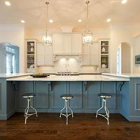 Maison Market - kitchens - two-tone cabinets, two-tone kitchen, gray cabinets, gray kitchen cabinets, gray blue kitchen cabinets, kitchen island, large kitchen island, marble counters, marble countertops, stainless steel oven, pot filler, pot filler faucet, dish racks, stainless steel microwave, built-in stainless steel microwave, lantern pendants, corbel supports, corbel counter supports, paneled oven hood, paneled hood, open cabinets, arched doorways, raised panel cabinets, blue gray kitchen cabinetry, hardwood floors, aluminium barstools, backless barstools, aluminium backless barstools, recessed lighting, pot lights, l-shaped kitchen, Visual Comfort Lighting Round Edwardian Entry Lantern, gray kitchen island, gray blue kitchen island, blue gray kitchen island,