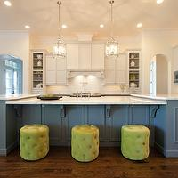 Maison Market - kitchens - two-tone cabinets, two-tone kitchen, gray cabinets, gray kitchen cabinets, gray blue kitchen cabinets, kitchen island, large kitchen island, marble counters, marble countertops, stainless steel oven, pot filler, pot filler faucet, dish racks, stainless steel microwave, built-in stainless steel microwave, lantern pendants, corbel supports, corbel counter supports, paneled oven hood, paneled hood, open cabinets, arched doorways, raised panel cabinets, blue gray kitchen cabinetry, hardwood floors, lime green ottomans, lime green button tufted ottomans, button tufted ottomans, green tufted ottomans, l-shaped kitchen, recessed lighting, pot lights, Round Edwardian Entry Lantern, gray kitchen island, oversized kitchen island,
