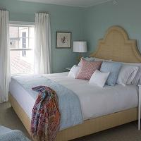 Jonathan Adler - bedrooms - raffia headboard, nailhead raffia headboard, raffia bed, nailhead raffia bed, blue grasscloth, blue grasscloth wallpaper, mismatched nightstands, white nightstands, coral lamps, white vinyl lamp shades, blue bedding, white curtains,