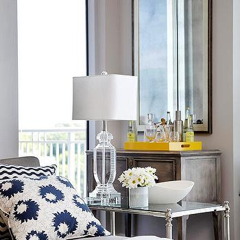 BHG - living rooms - gray cabinet, bar cabinet, gray bar cabinet, lacquer tray, yellow tray, yellow lacquer tray, crystal lamp, crystal table lamp, polished nickel end table, glass top end table, decorative white bowl, chaise lounge, gray chaise lounge, white and navy blue pillows,