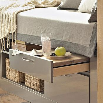 BHG - living rooms - window seat, built in window seat, gray window seat, window seat storage, window seat storage compartments, gray blanket, 2 tone gray blanket, gray shams, pull out table, window seat table, window seat pull out table, built in table, window seat built in table, built in window seat table,