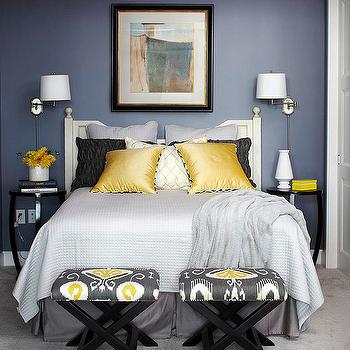 BHG - bedrooms - blue walls, blue bedroom walls, yellow and blue bedroom, yellow and blue bedroom design, white headboard, white wood headboard, swing arm sconce, bedroom sconces, bedroom reading lights, black lacquer nightstand, lacquer nightstand, glossy black nightstand, gray blanket, gray quilt, gray bed skirt, yellow pillows, yellow and black pillows, gray shams, ikat ottoman, x bench, x ottoman, ikat bench, ikat stool, yellow and gray ikat, yellow and gray ikat fabric, yellow and gray ikat ottoman, yellow and gray ikat stool, Bansuri Fabric,