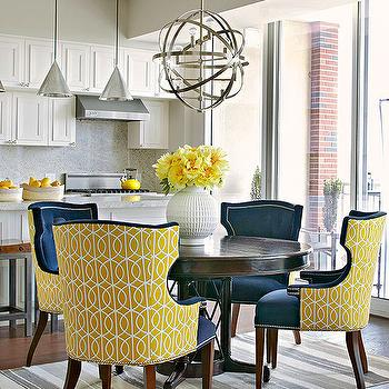 BHG - dining rooms - sphere chandelier, nickel sphere chandelier, round dining table, yellow dining chairs, navy blue dining chairs, blue dining chairs, tufted dining chairs, blue tufted dining chairs, dwell studio gate. dwell studio gate citrine, gate citrine, white and gray rug, striped rug, white and gray striped rug, nailhead dining chairs, yellow and navy dining room, yellow and navy blue dining room, Dwell Studio Gate Citrine,